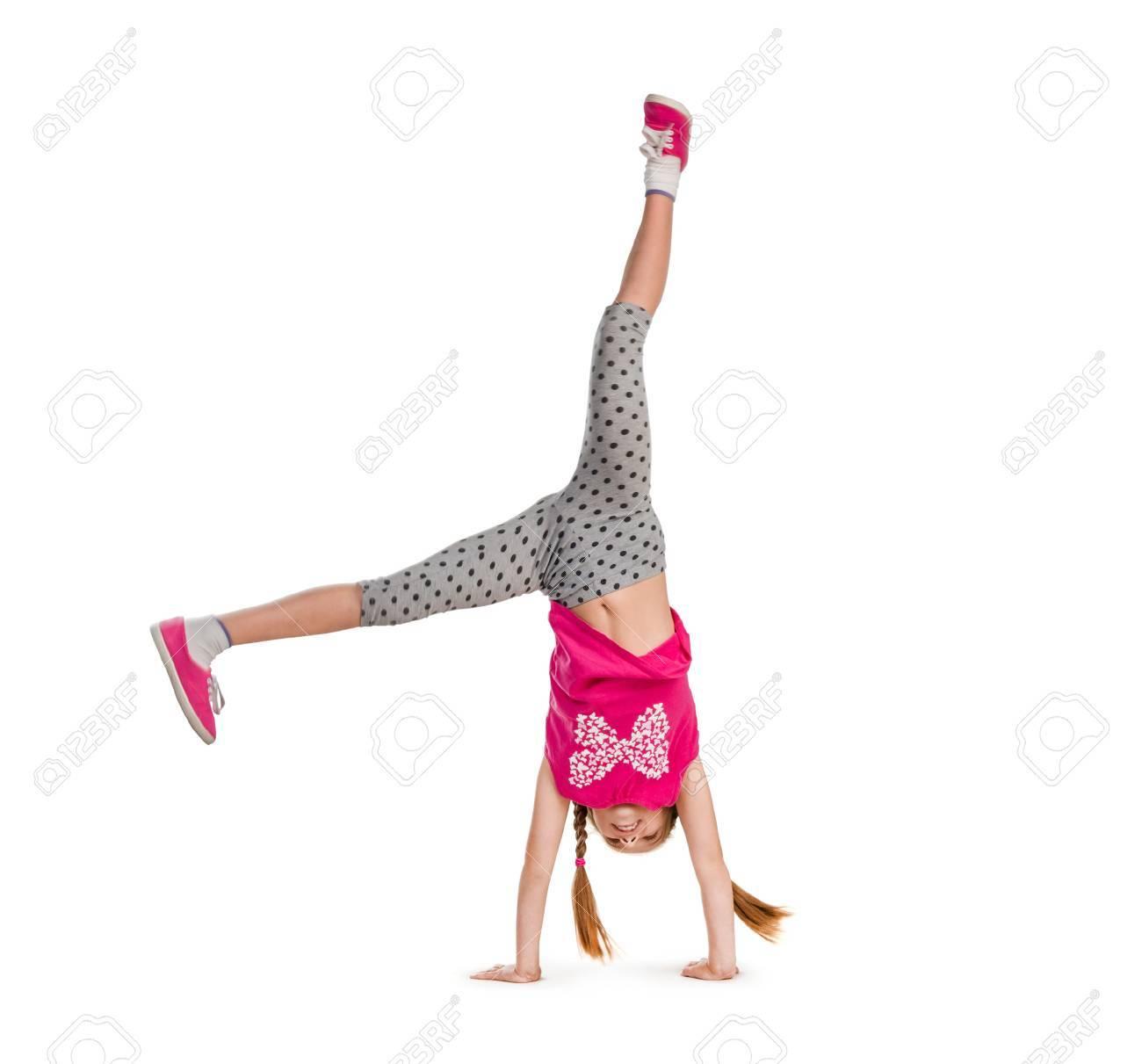 little girl turning handsprings in a studio - 44481610