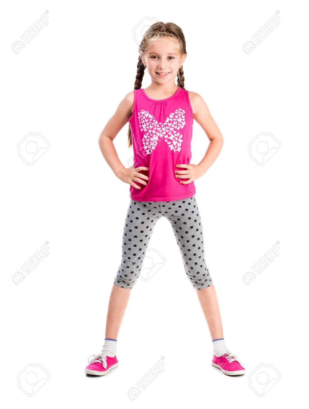 little girl standing with hands on sides doing fitness - 44481637