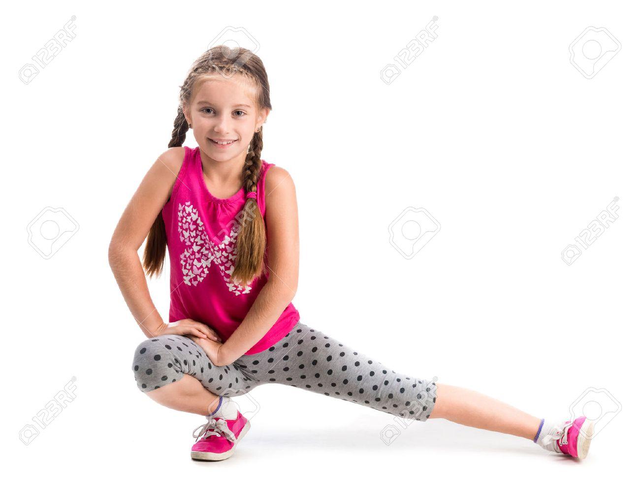 smiling little girl doing exercise isolated on white background - 44481647