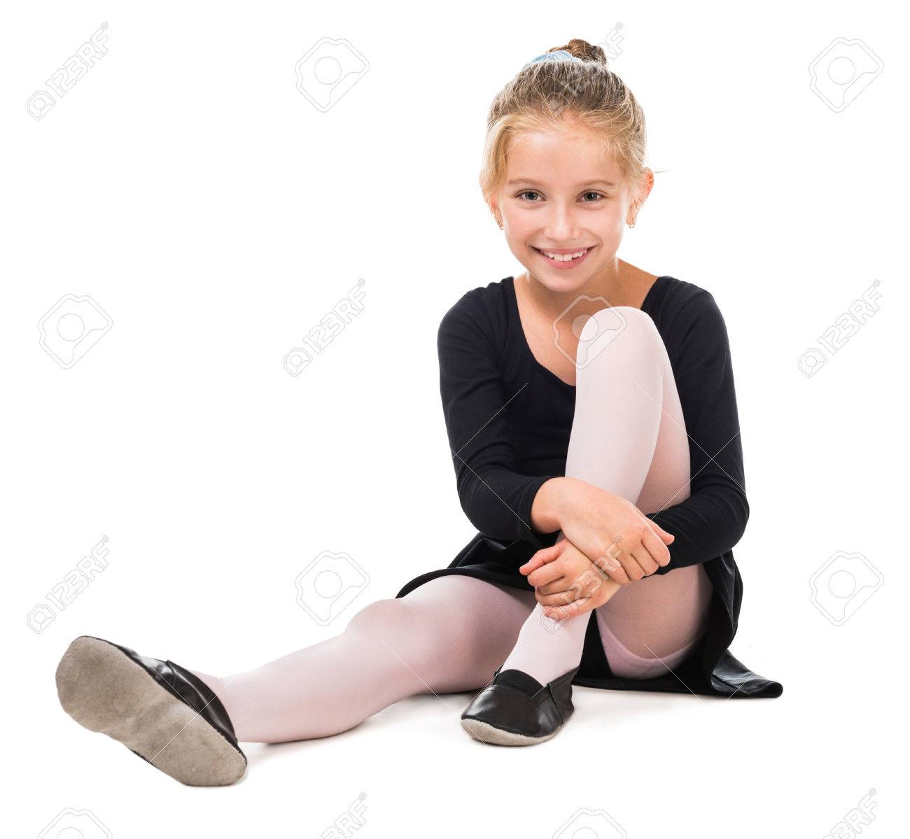 smiling little gymnast on the floor isolated on white background - 44711613