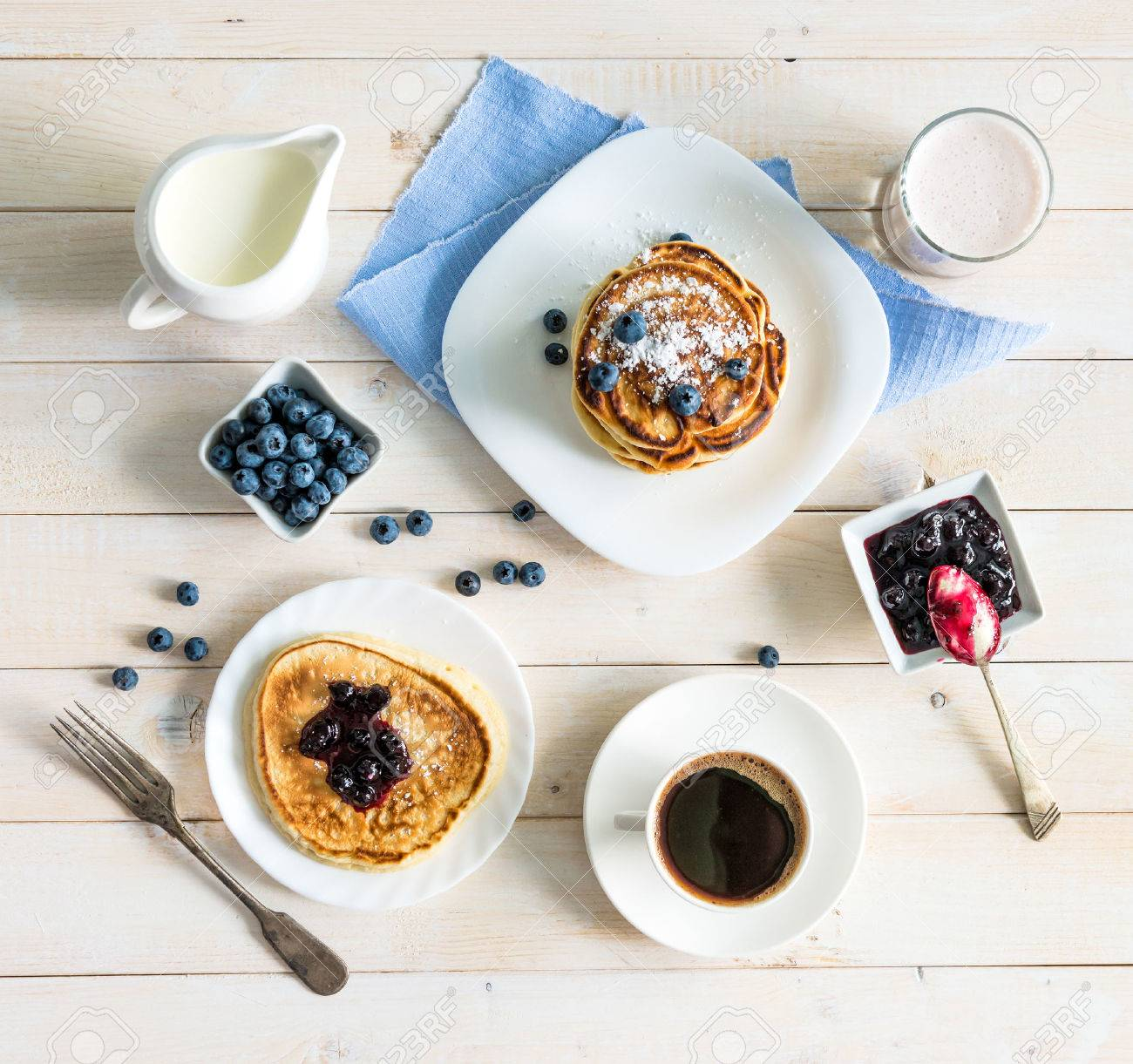 pancakes with blueberry and coffee on wooden background. top view - 45008484