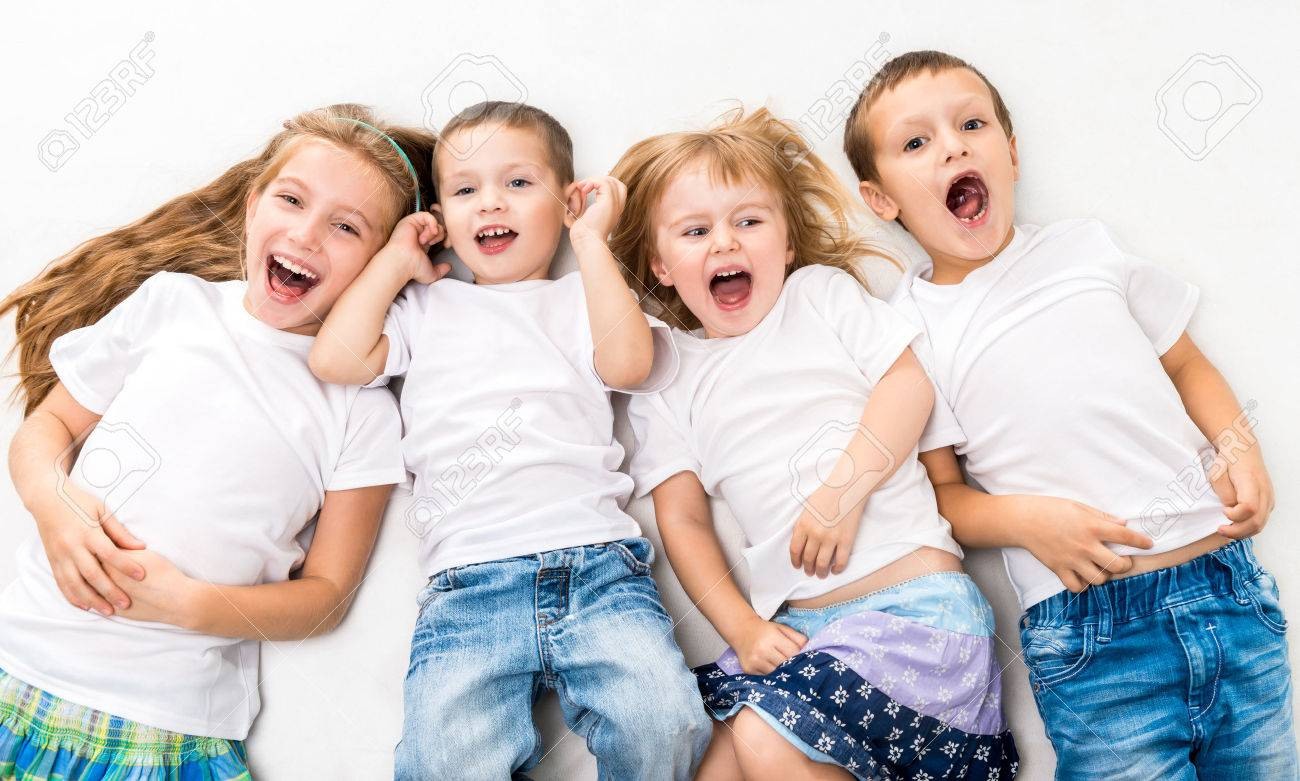 children in white shirts lying on the floor isolated on white background - 45297054