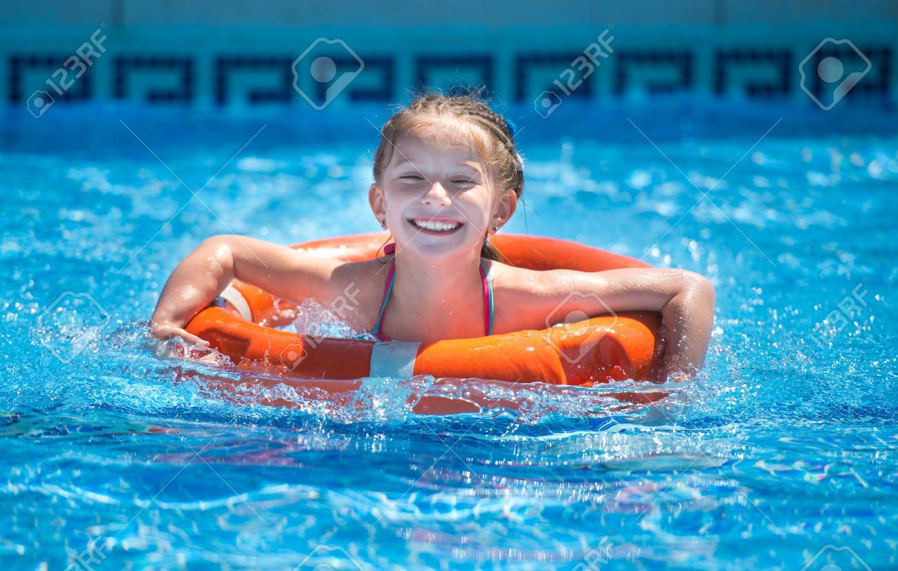 happy little girl swims with a lifeline in the pool in summer Stock Photo -  45900112 c64368fe3