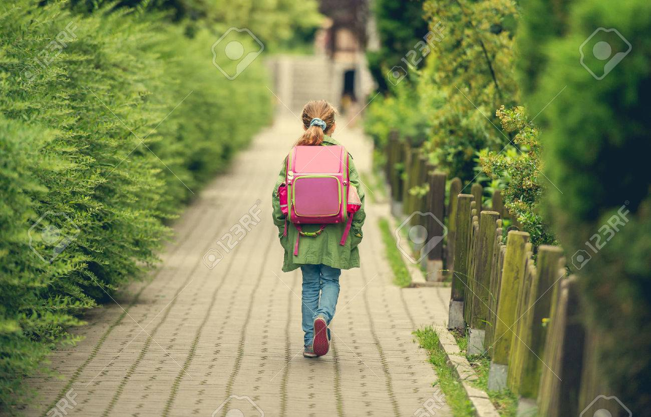 little girl with a backpack going to school. back view - 47391319