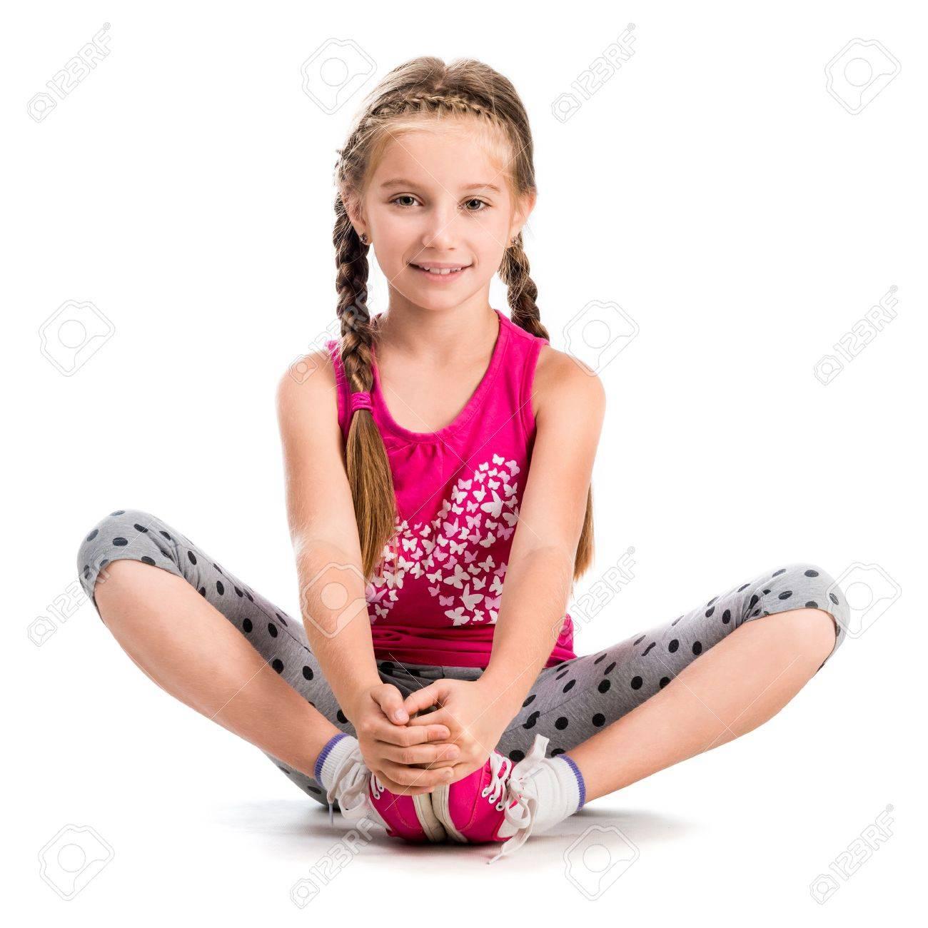 little girl doing yoga isolated on white background - 47390318