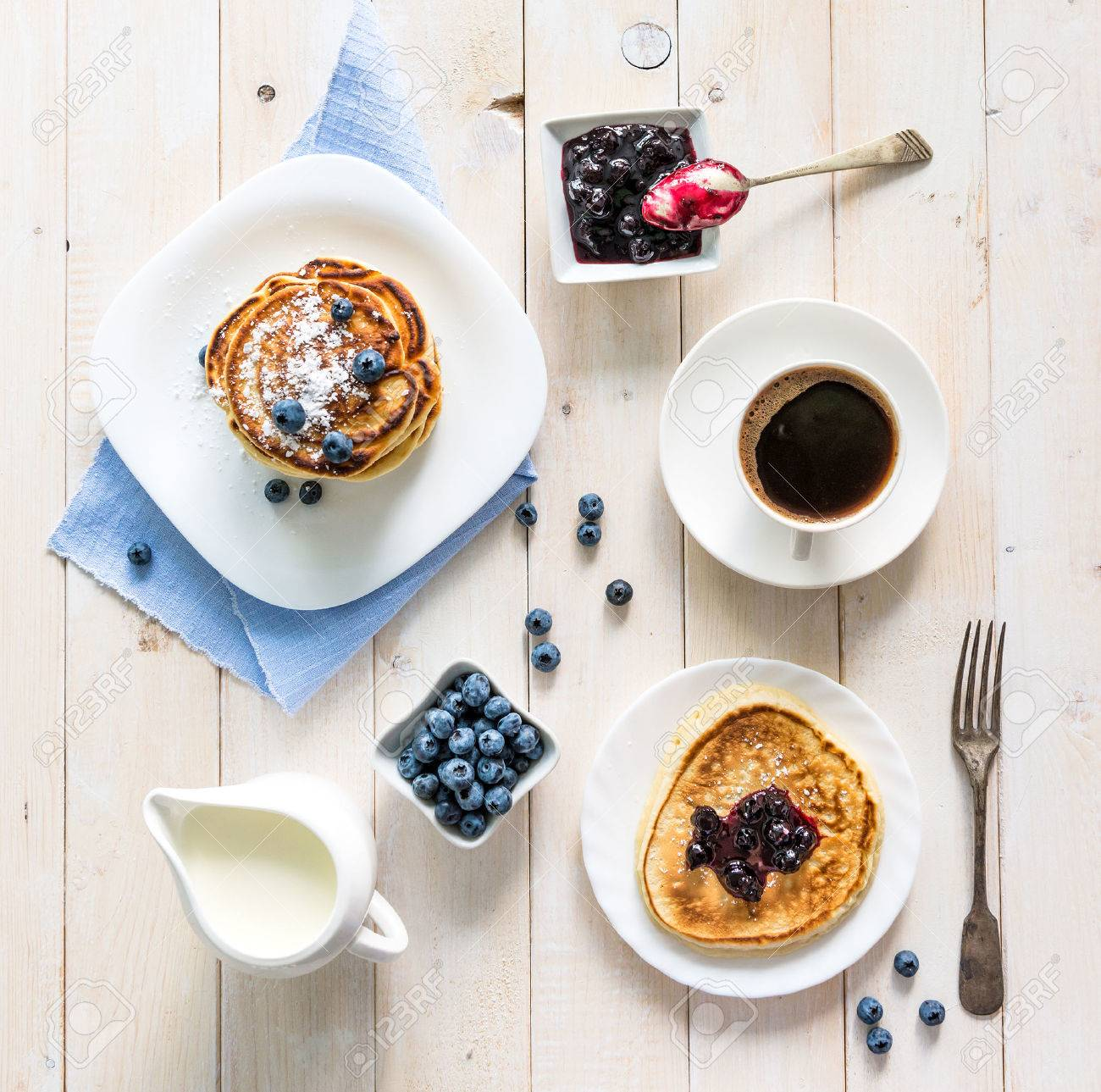 pancakes with blueberry and coffee on wooden background. top view - 47389761