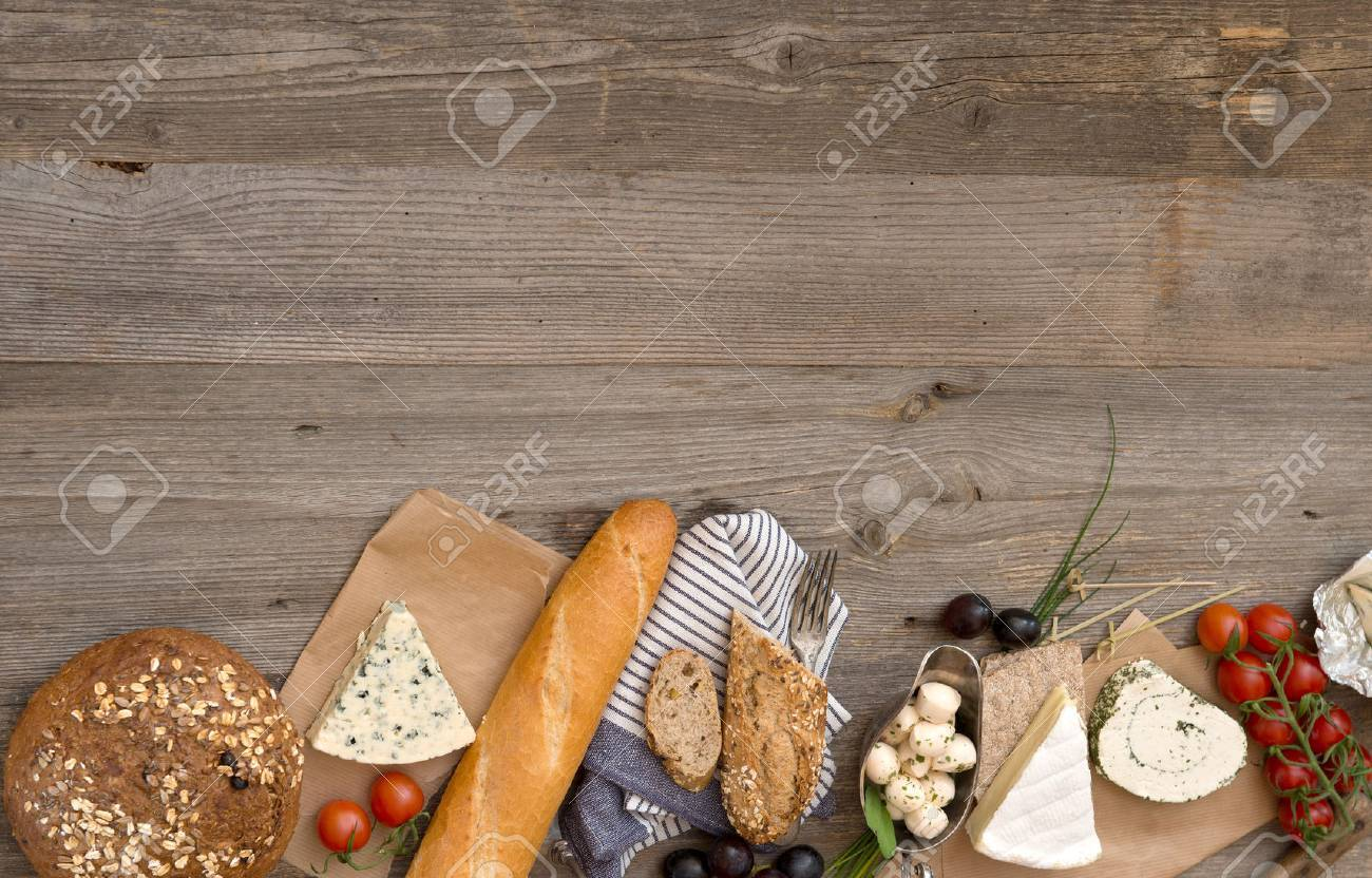 French food ingredients on a wooden table with space for text - 49147503
