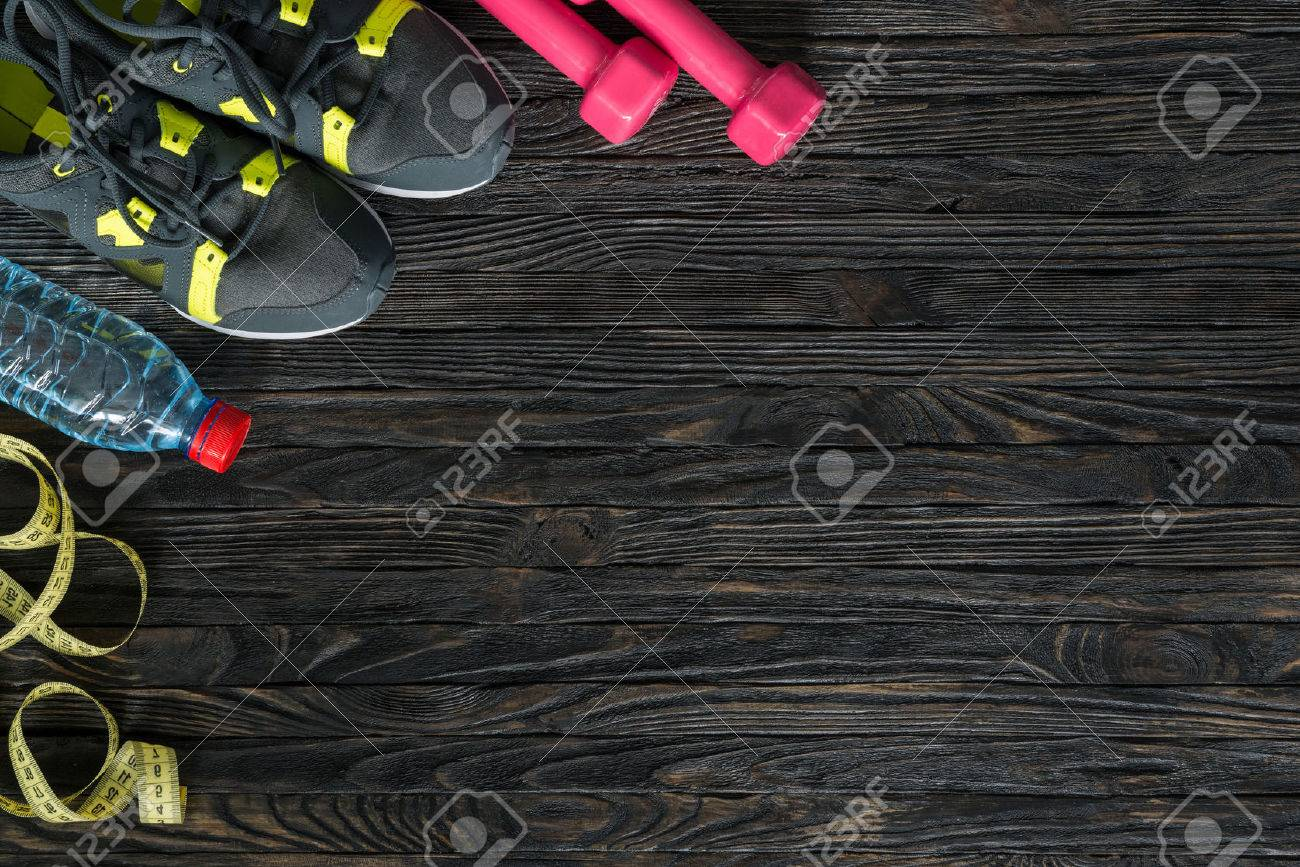 sport fitness items on dark wooden background with empty text space - 50806268