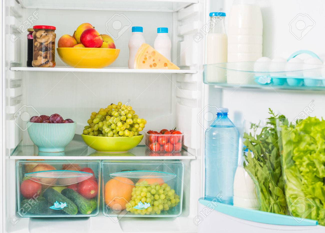 fridge inseide filled with different fresh food - 51676942