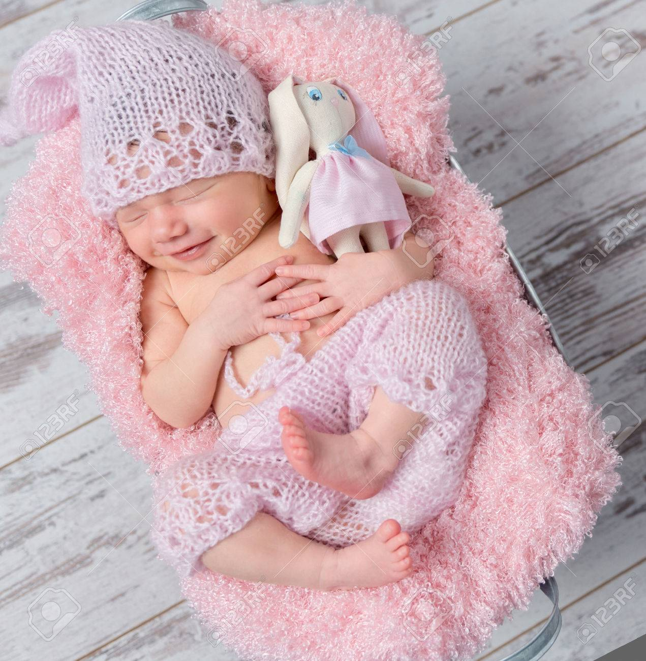 Cute Smiling Newborn Baby Girl In A Pink Hat Sleeping With A Stock Photo Picture And Royalty Free Image Image 58656275