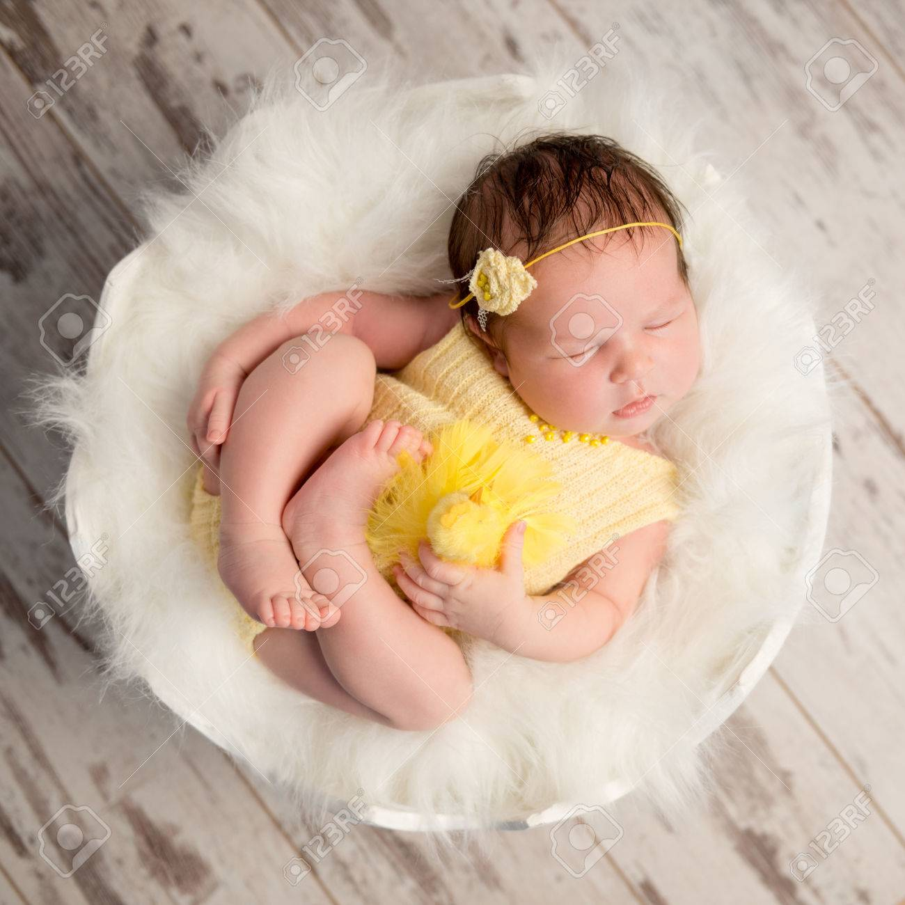 Funny Sleeping Baby In Yellow Romper With Chicken Toy On Round Stock Photo Picture And Royalty Free Image Image 61324926