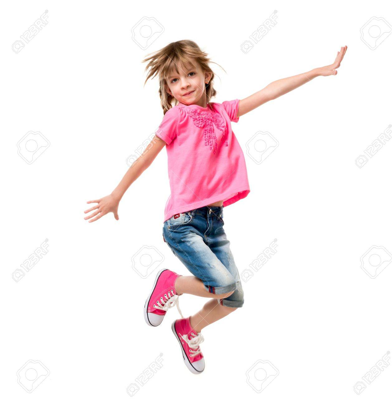 pretty little girl in pink jumping and laughing isolated on white background - 66160246