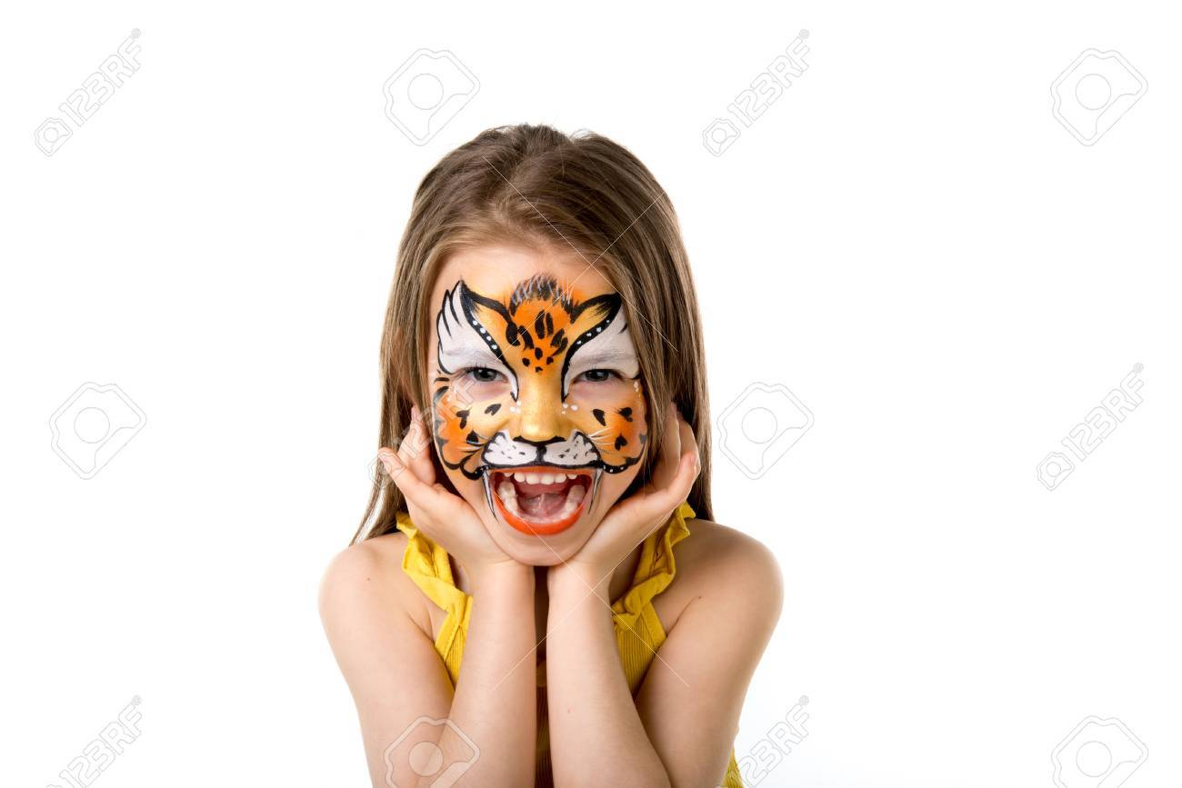 cute little girl with colorful painted face like tiger - 66160247
