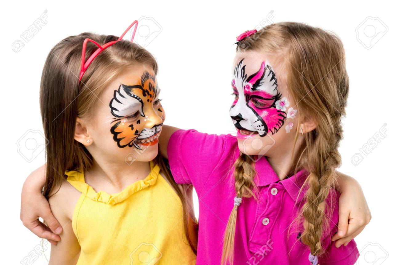 two little girls with painted faces - 71105592