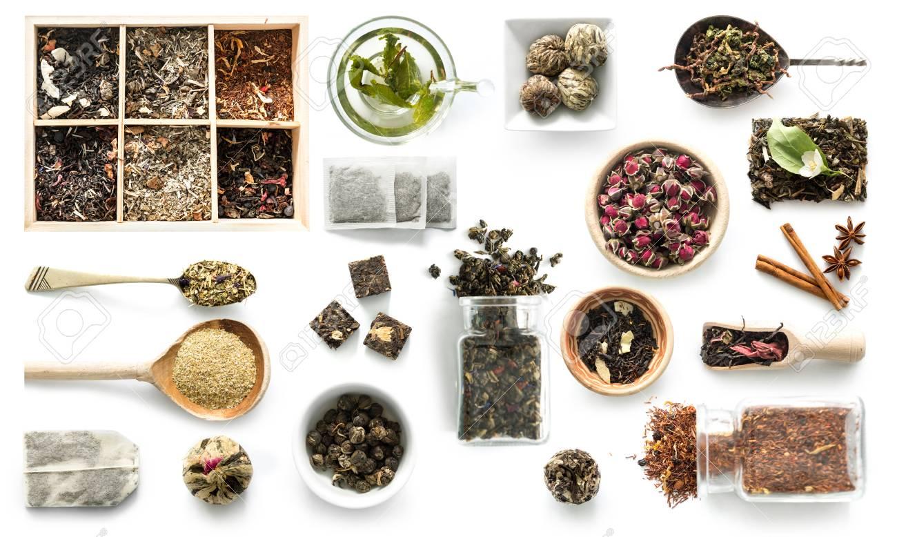 Various kinds of tea, rustic dishware, cinnamon, topview - 80446796