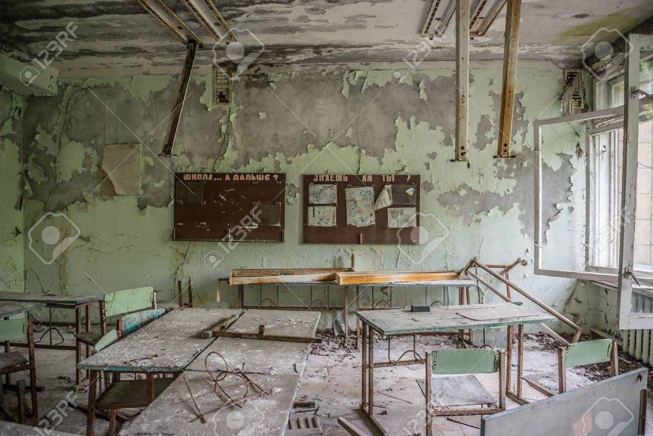 abandoned class room with furniture and debris in Pripyat - 84754360