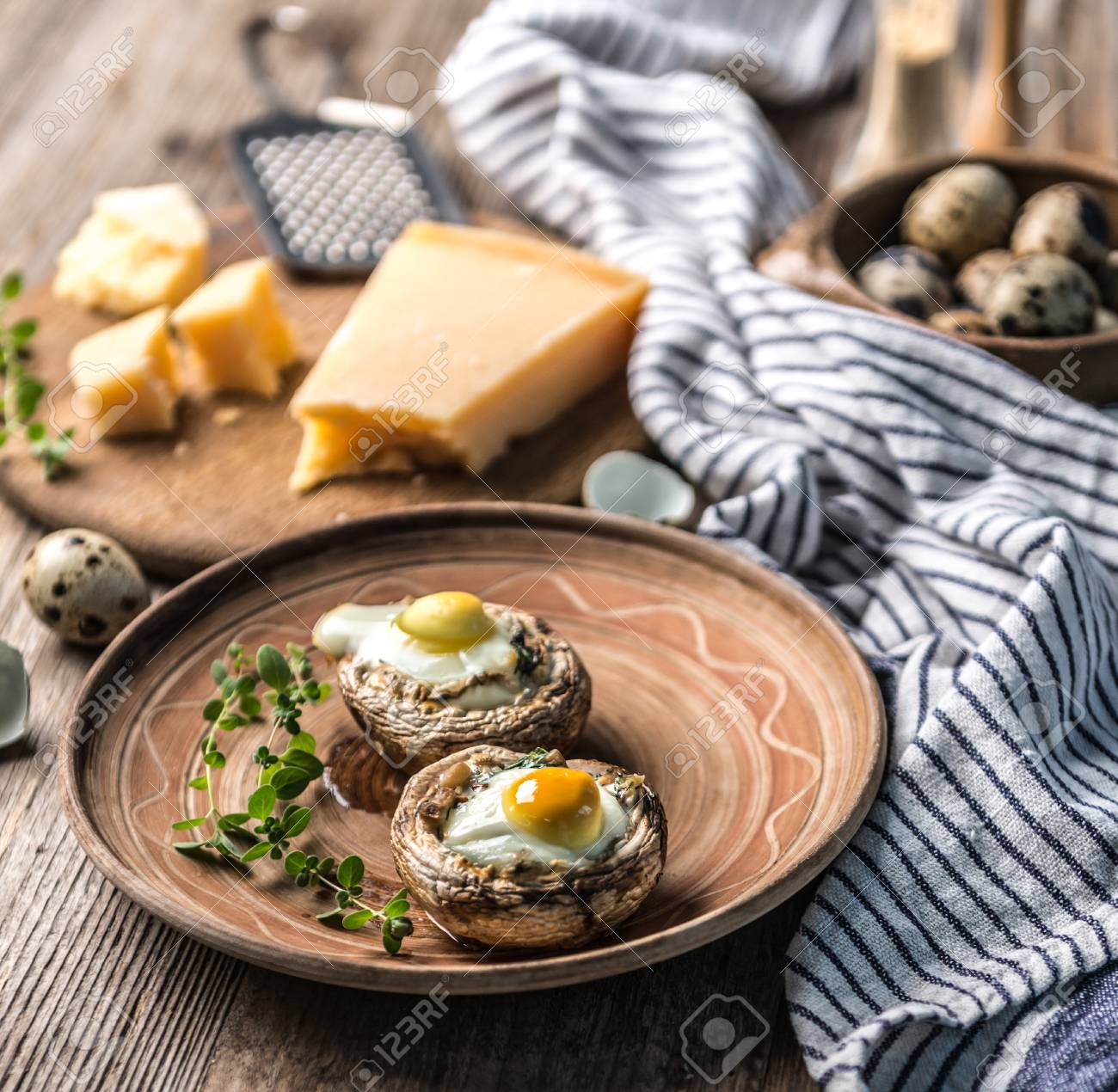 Stuffed mushrooms with quail eggs and parmesan cheese. - 91246149