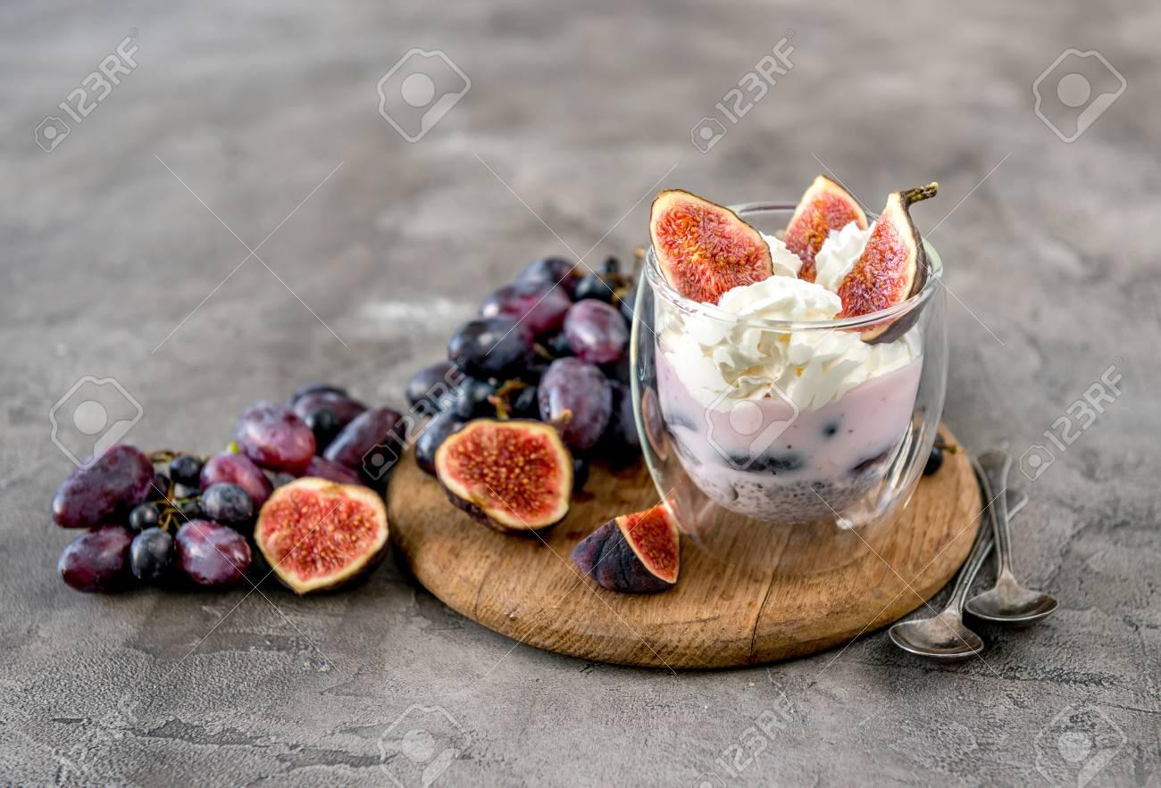An useful dessert - yogurt, muesli and figs with grapes - 91179588