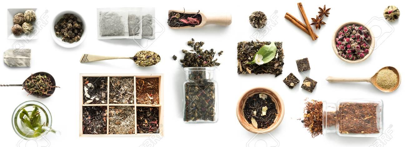Various kinds of tea, spoons and rustic dishware, brewed green tea, cinnamon - 91697268