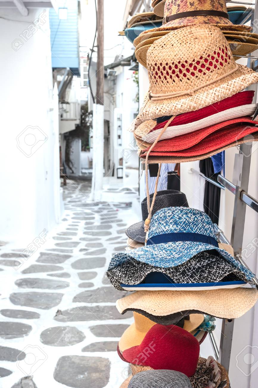 cae33ced63d71 Straw summer hats on market stall outdoor Stock Photo - 105805160
