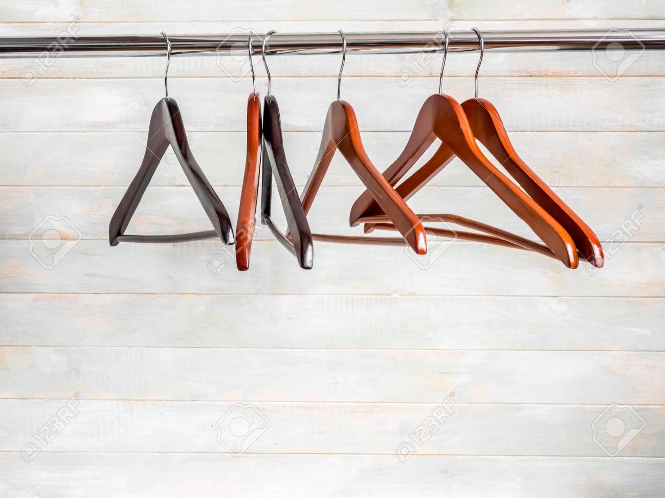 Brown wooden hangers on the rack - 105808910