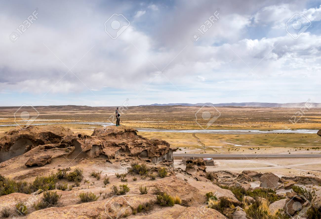 Man standing on the edge of rocky hill in Bolivia - 112880337