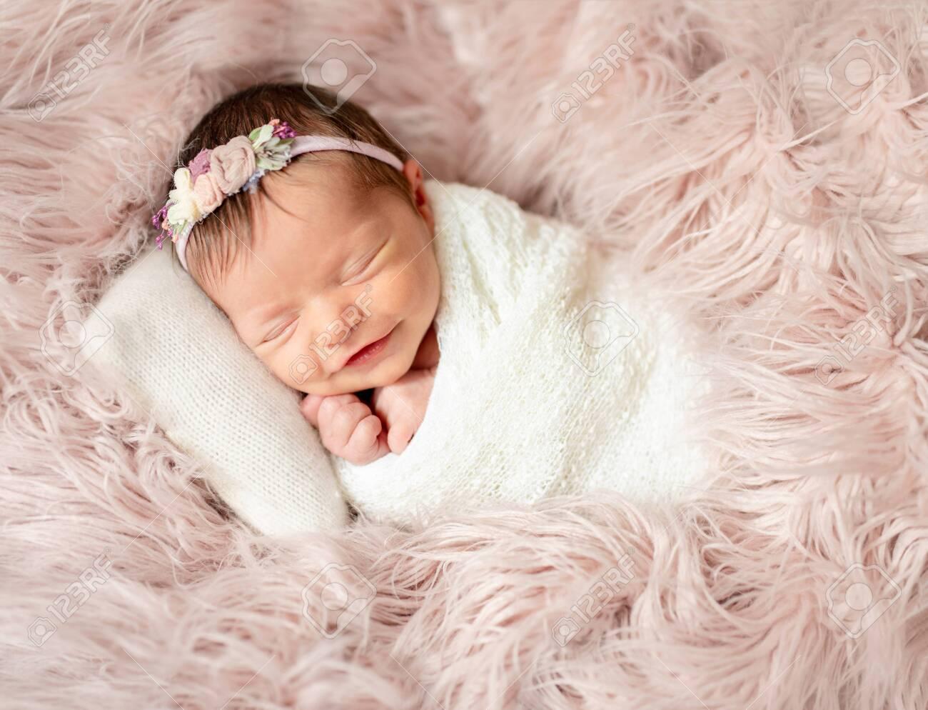newborn sleeping on baby bed - 121651036