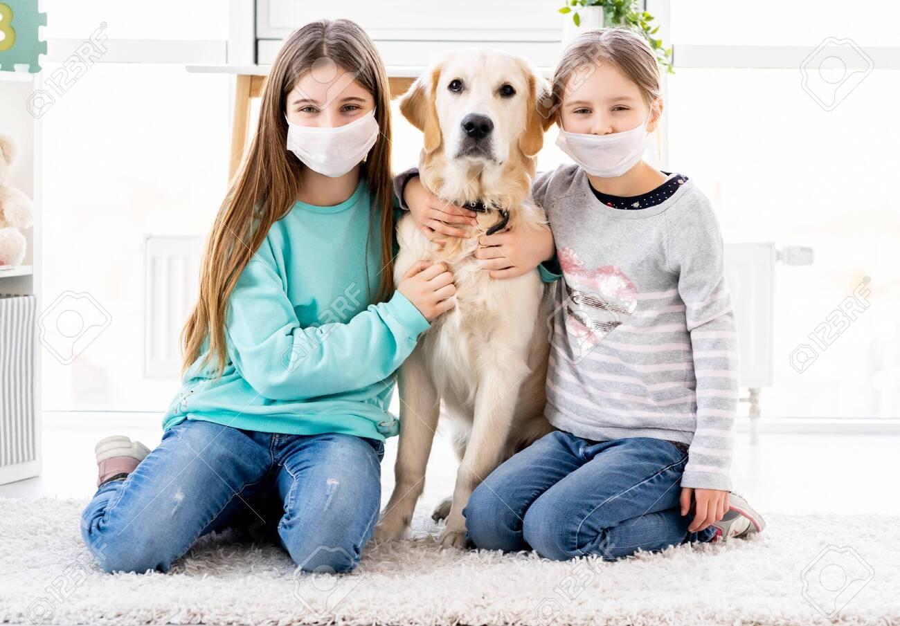 Cute sisters in medical masks - 143062567