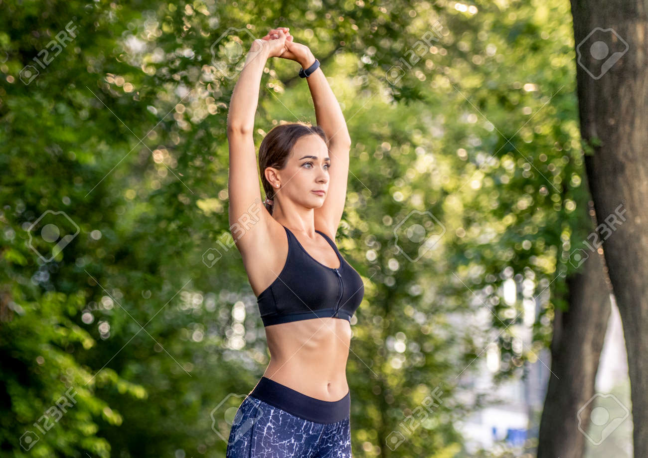 Girl doing yoga at nature - 172489905