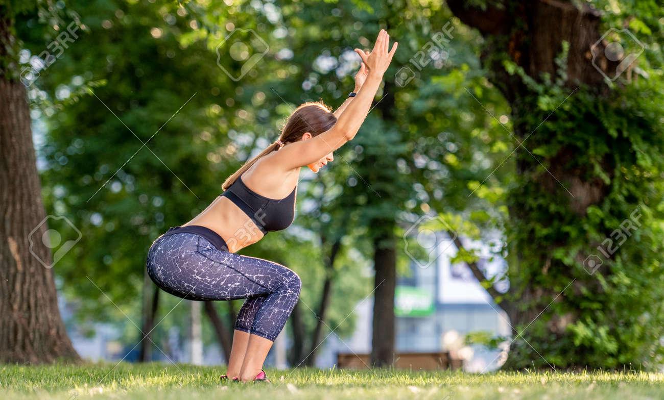 Girl doing yoga at nature - 172489910