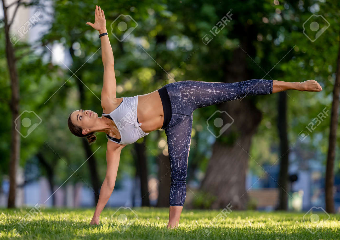 Girl doing yoga at nature - 172489925