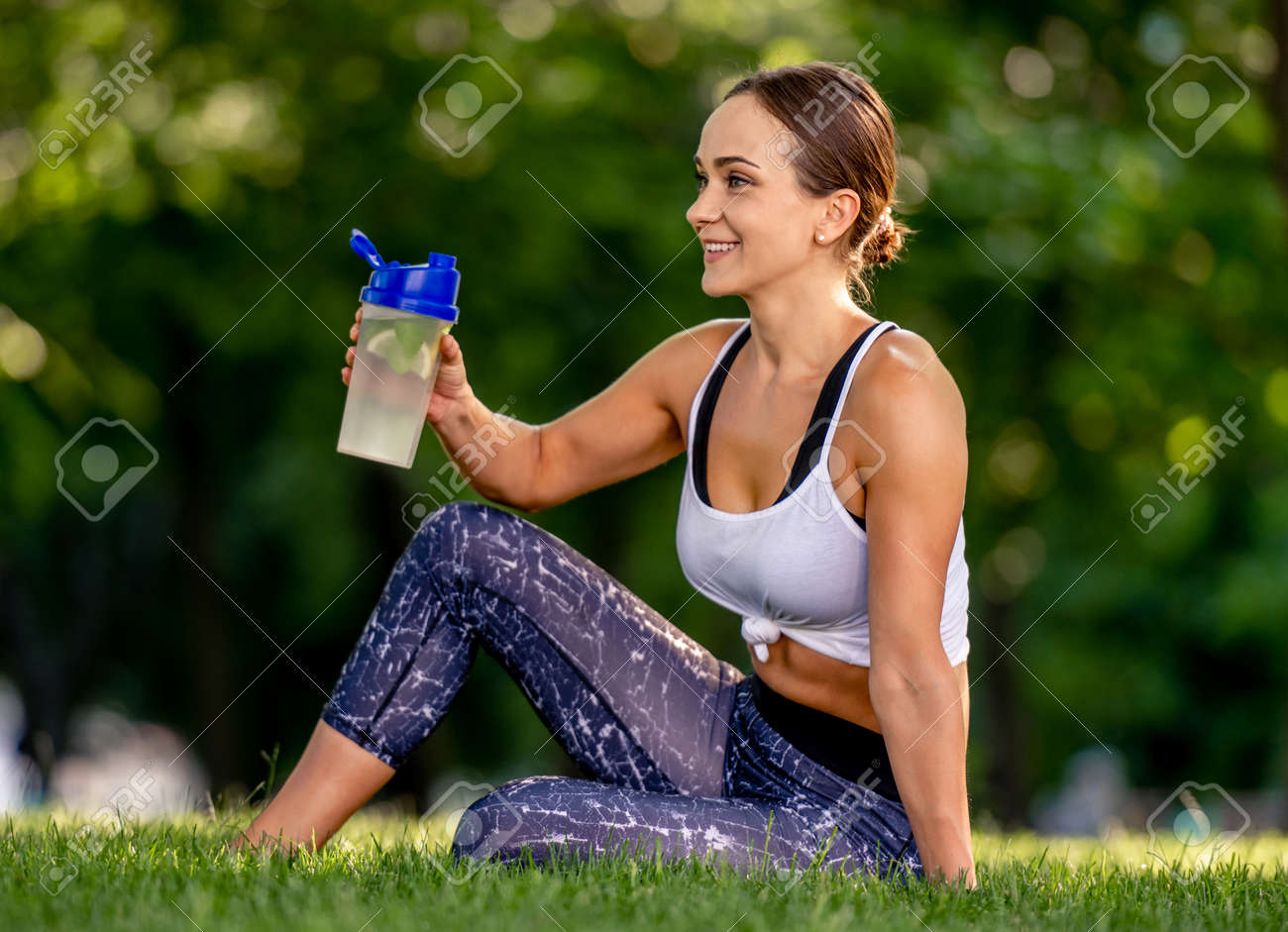 Girl with water during yoga - 172489933