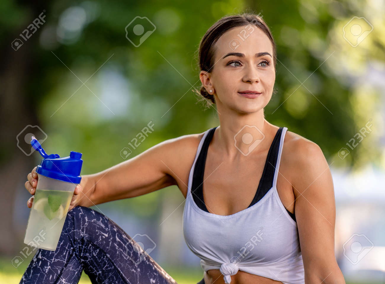 Girl with water during yoga - 172489934