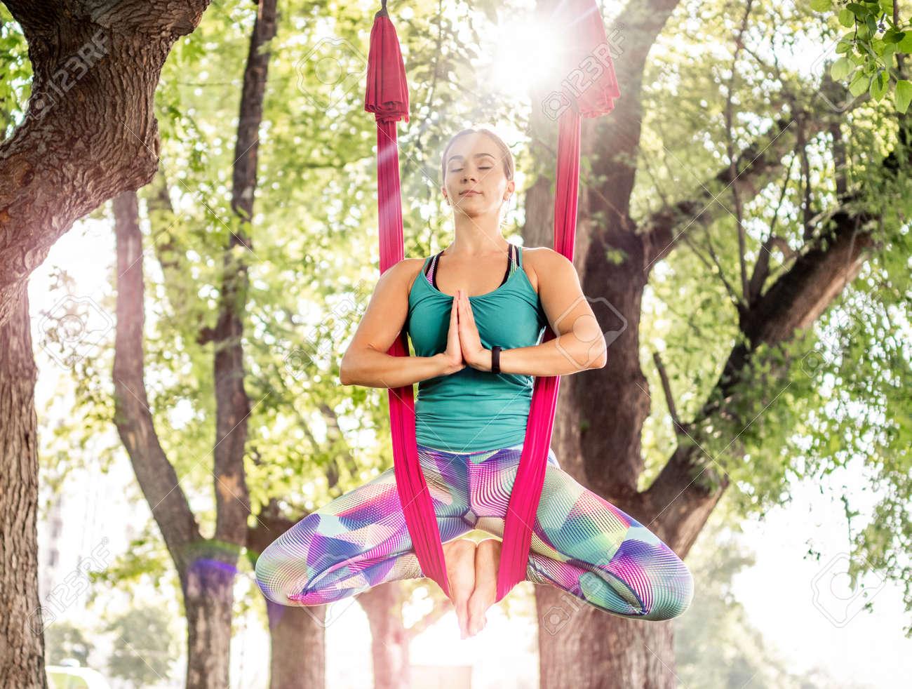 Girl doing fly yoga - 172489945
