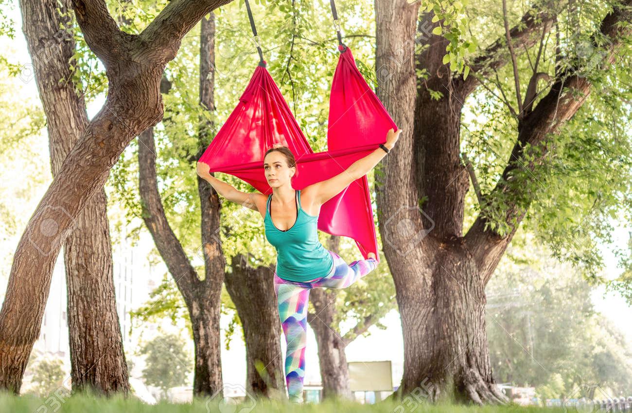 Girl doing fly yoga - 172489947