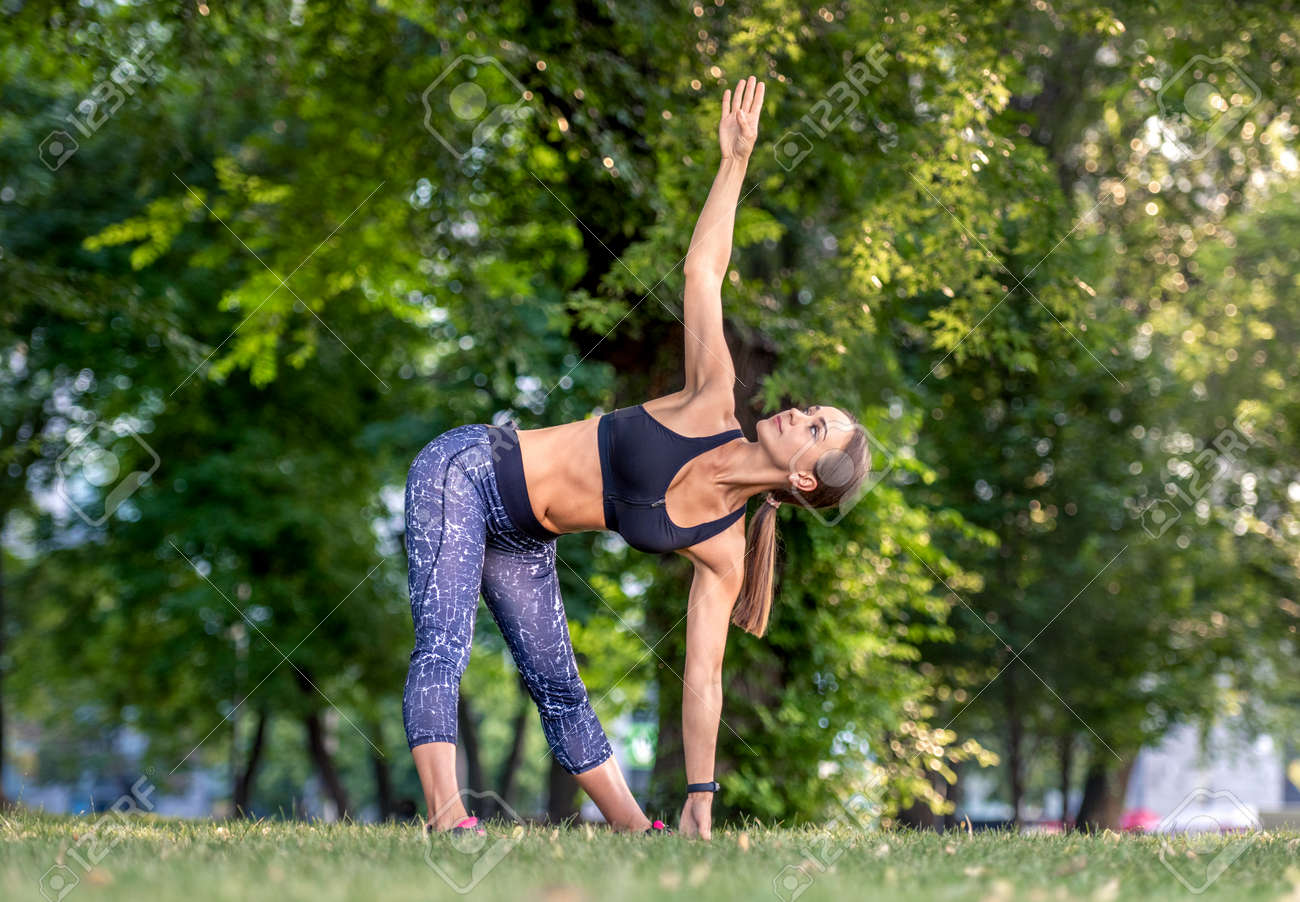 Girl doing yoga at nature - 172749692