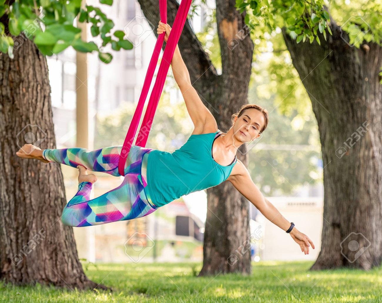 Girl doing fly yoga - 172872123