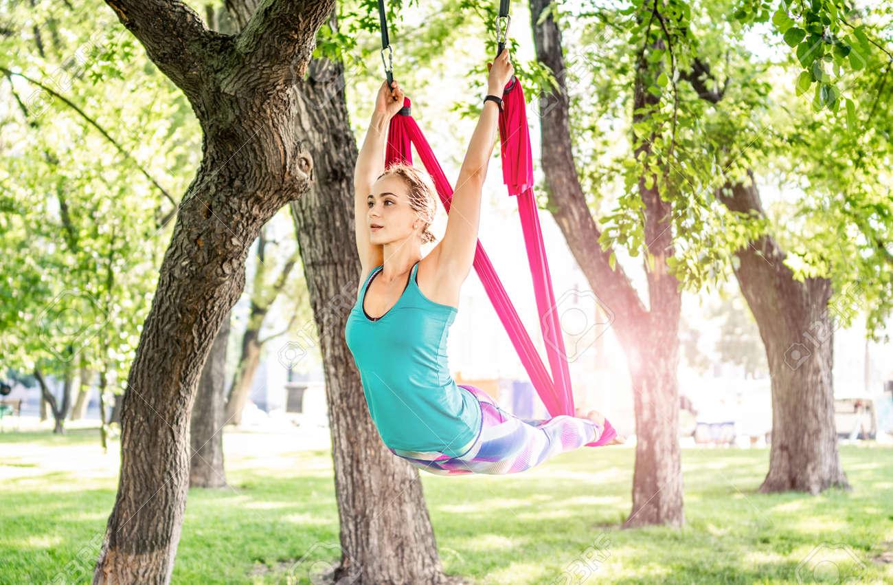 Girl doing fly yoga - 172872127