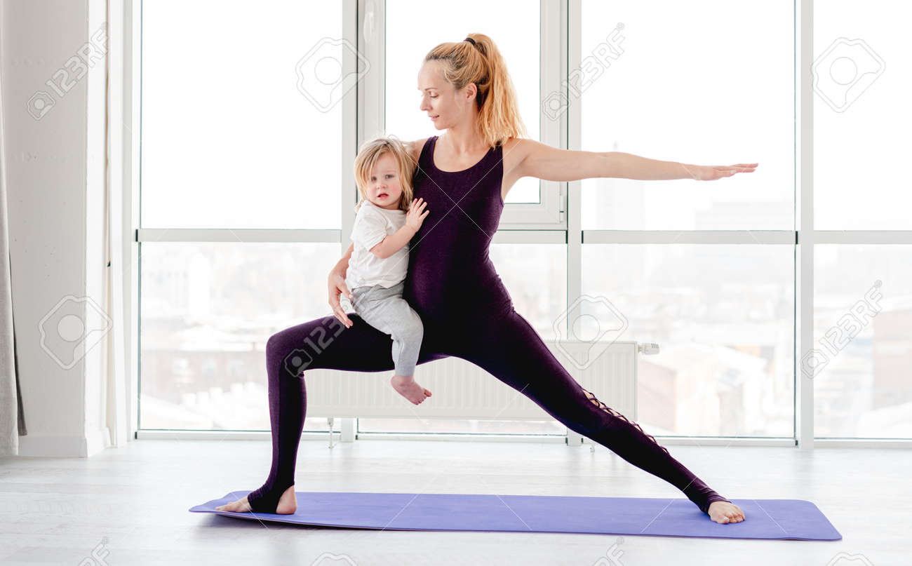 Mother and child practicing yoga - 173370107