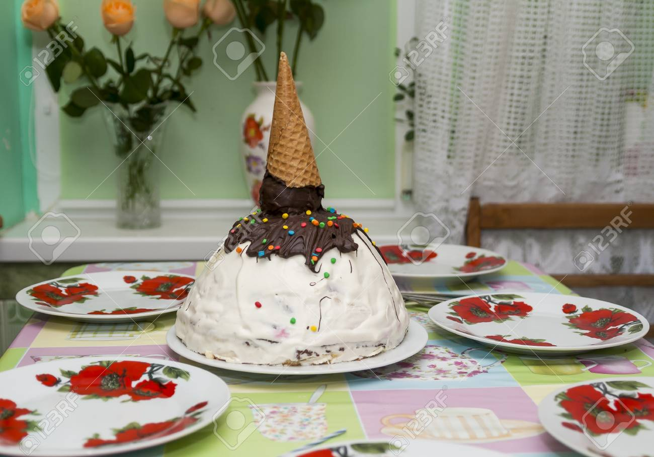 Birthday Cake In The Form Of A Cone With Ice Cream On Table Stock