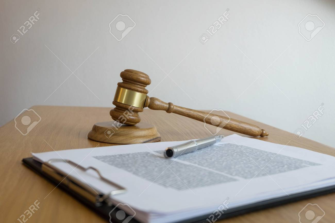 Close up object law concept. Judge gavel with justice lawyers and documents working on table. - 118467267