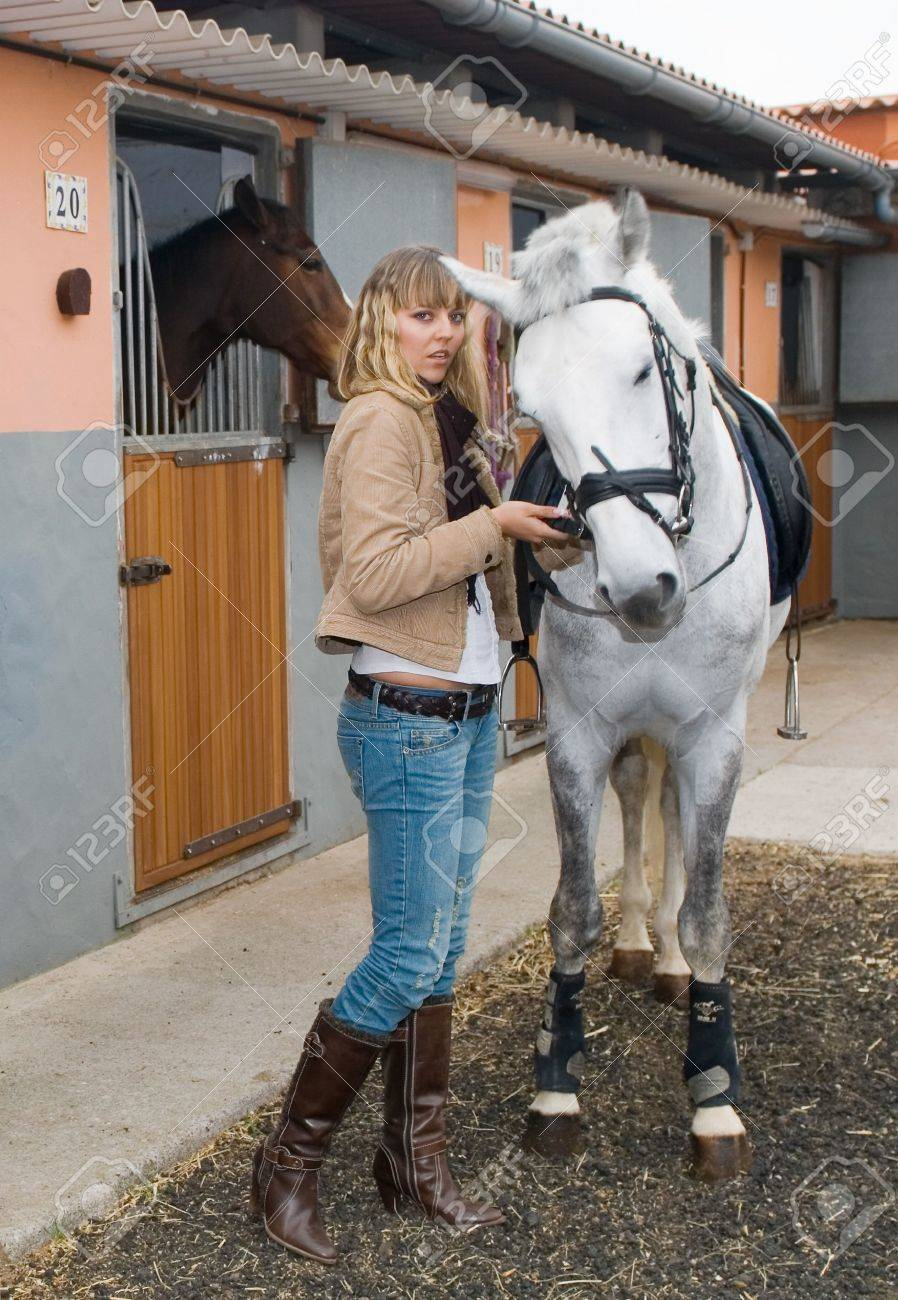 Young girl with a horse in the stable - 2802685