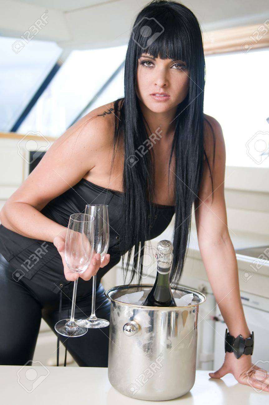 young sexy woman with champagne bottle in new year party or other Stock Photo - 5527885