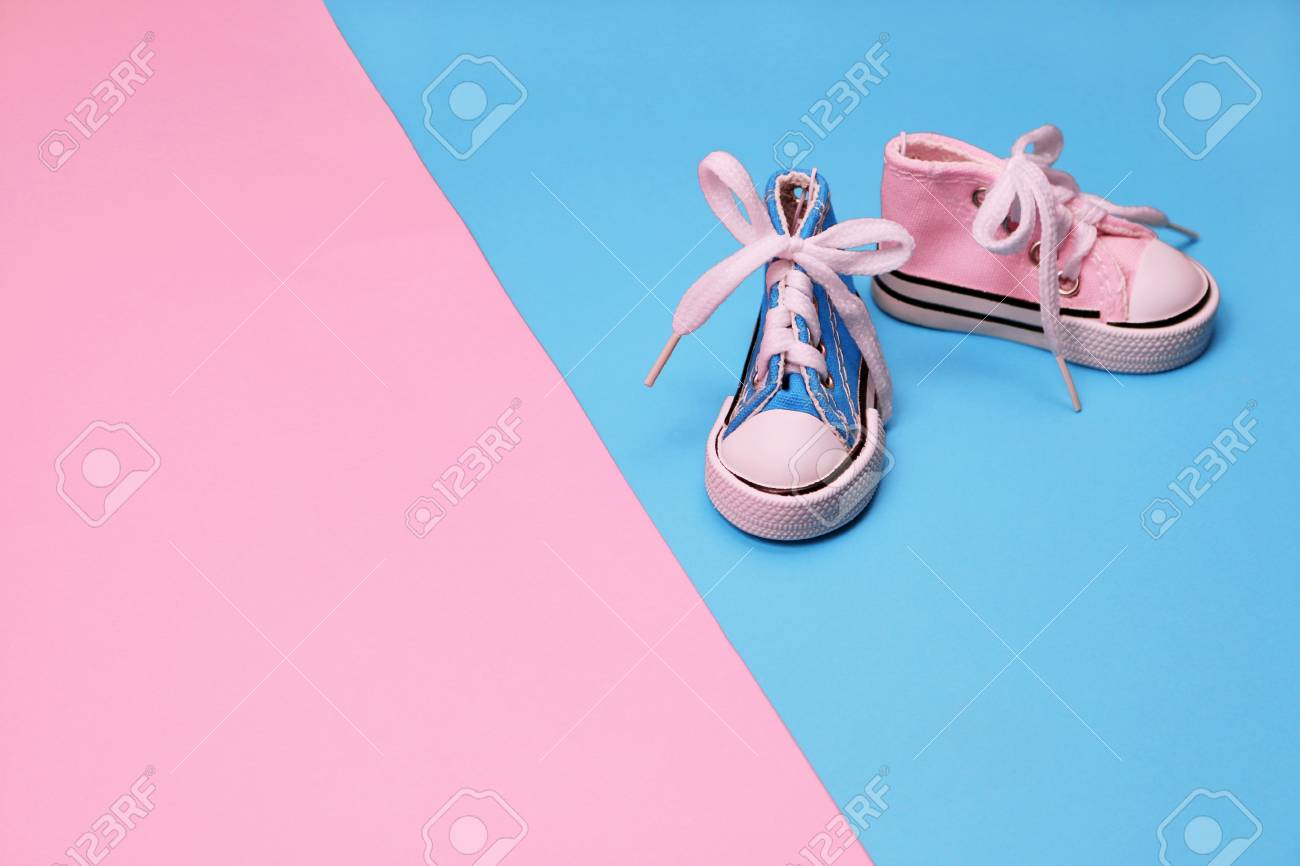 Baby Sneakers On Pink And Blue Background Baby Shower Concept