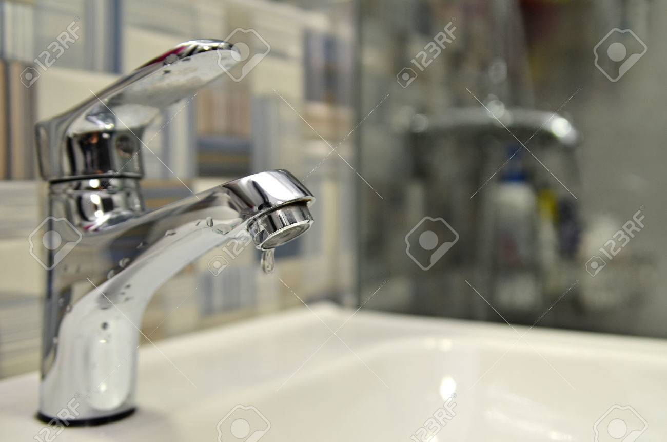 Bathroom Tap Leaking Water Drops. Saving Water Concept Royalty Free ...