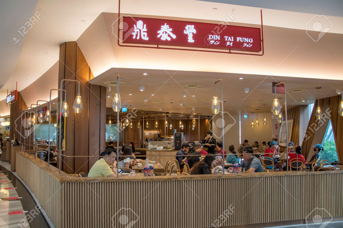 Singapore - Dec 31, 20120: Michelin star awarded Din Tai Fung store front located inside the Jewal Changi Airport in Singapore. - 164269448