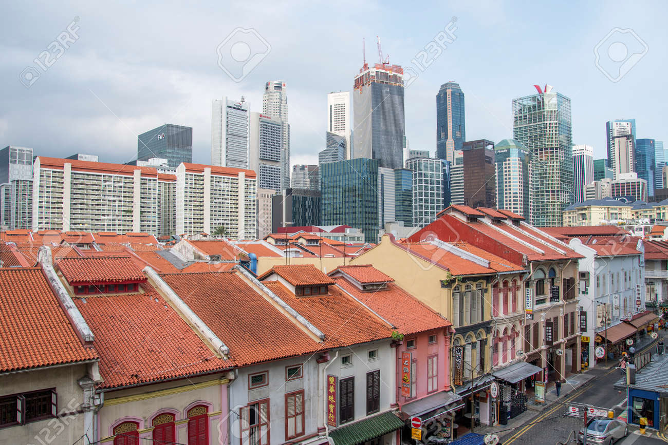 Singapore - Mar 19, 2021: Aerial view cityscape of Singapore Chinatown with downtown skyscrapers of the business financial district in the background. - 166241407