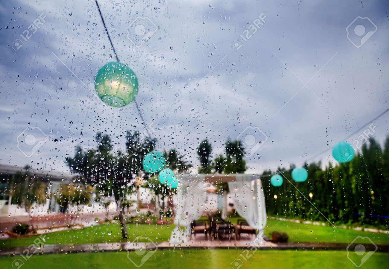 Outdoor ceremony. Decoration of celebrations. Rain through the window. Wedding planner Stock Photo - 50206713