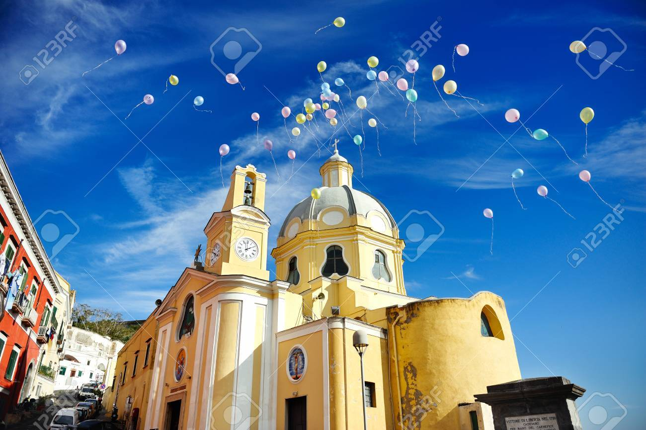 beautiful panoramic view of the colorful island of Procida in the Gulf of Naples, church of Procida, Mediterranean sea, Italy - 26403575