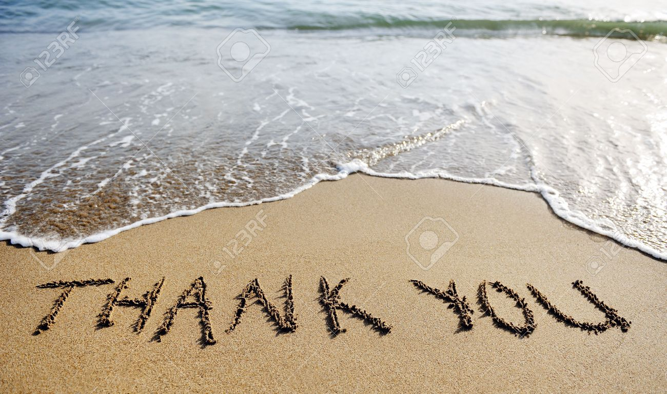 thank you words written on the sand of the beach - 30185128